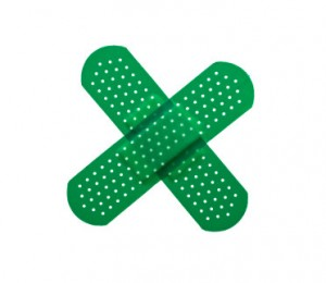 green band-aids formed in a cross